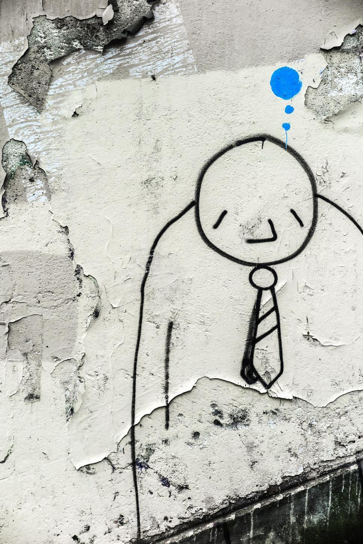 Download Free Stock HD Photo of Paris street art of cartoon man Online