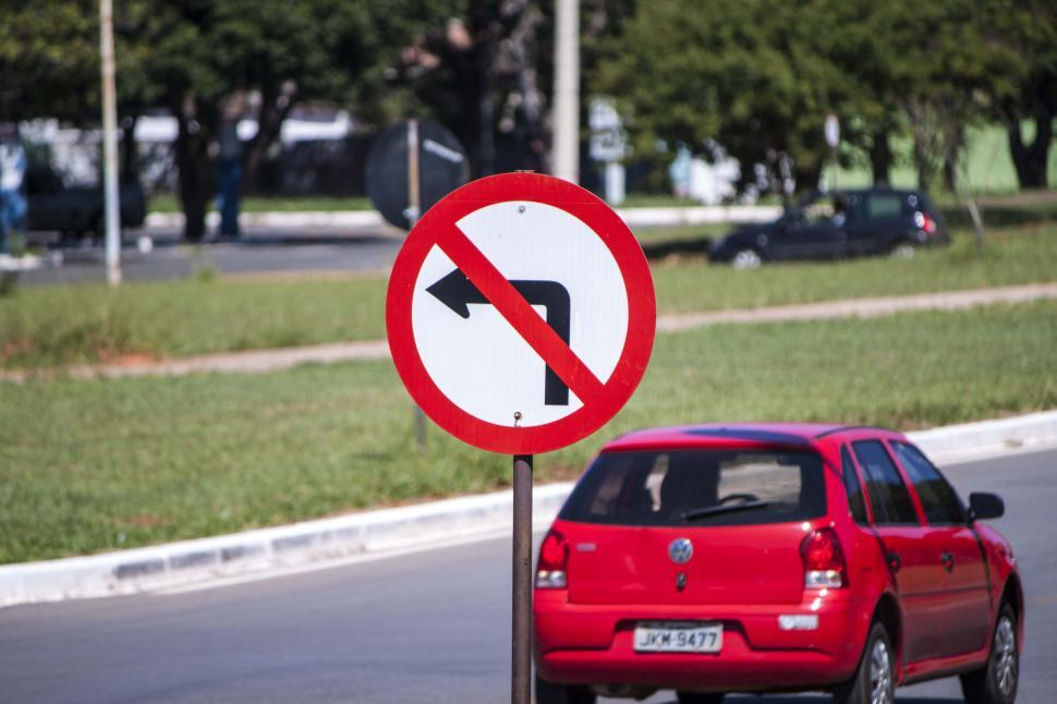 Download Free Stock HD Photo of No left turn sign with car in background Online