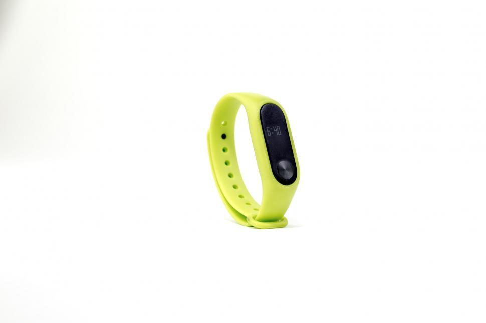 Download Free Stock HD Photo of Lime Green Fitness Tracker Online