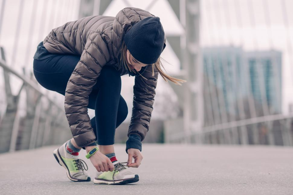 Download Free Stock HD Photo of Athlete Tying Running Shoes Online