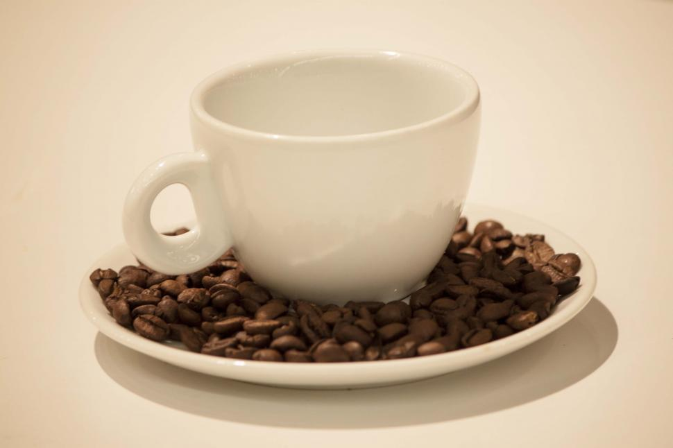 Download Free Stock HD Photo of Coffee cup and beans top angle Online