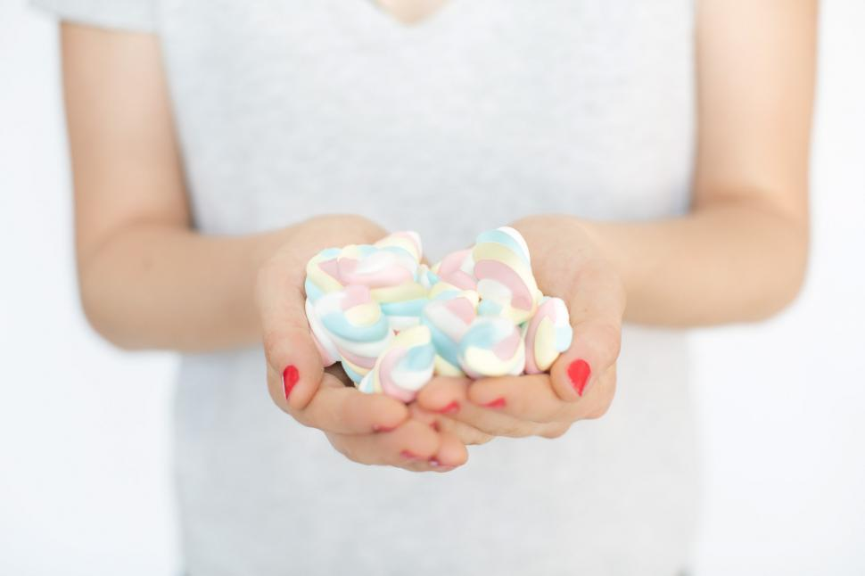 Get Free Stock Photos of Hands Holding Marshmallow Candy