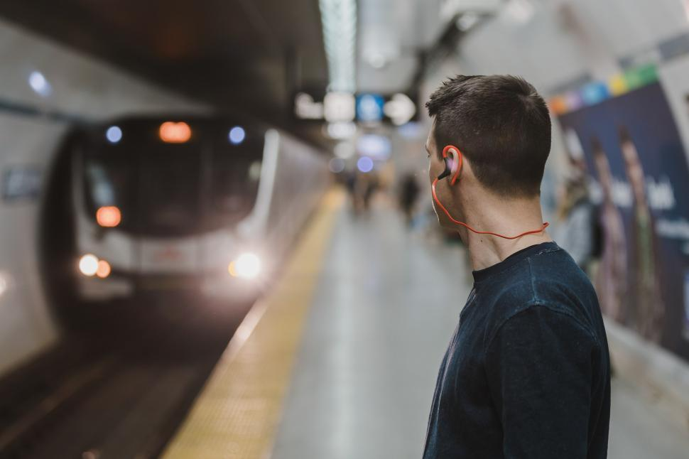 Download Free Stock HD Photo of Commuter Waiting For Subway Online
