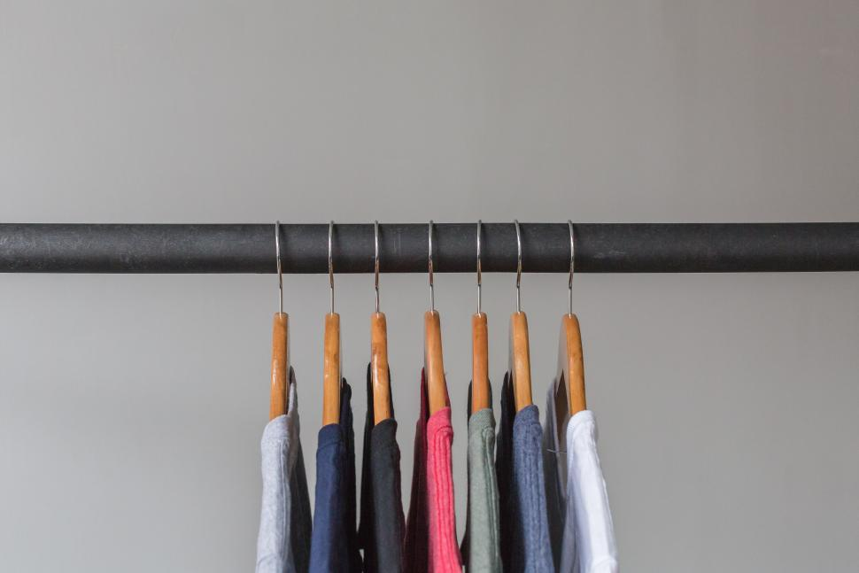 Download Free Stock HD Photo of T Shirts Hanging On Rack Online