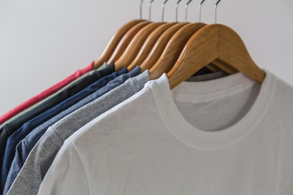 Download Free Stock HD Photo of Tshirts on wooden hangers Online