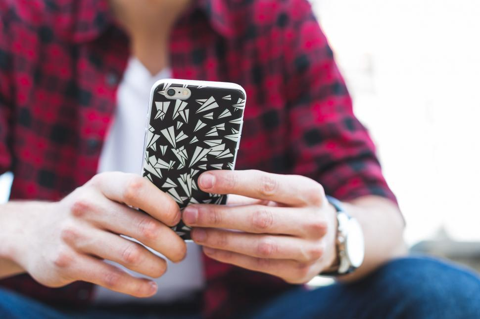 Download Free Stock HD Photo of Teen Texting On Smartphone Online