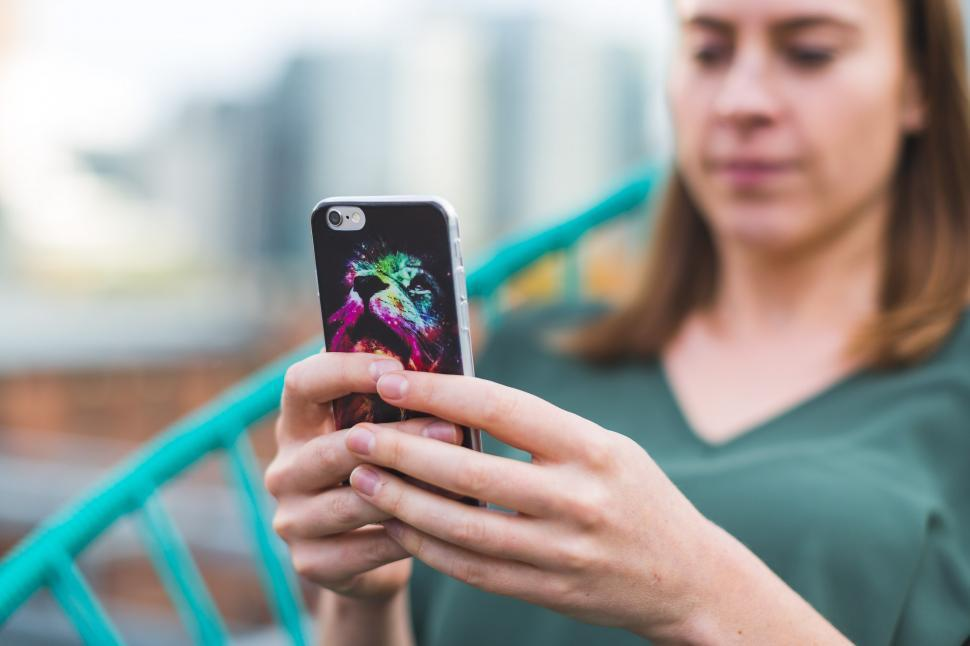 Download Free Stock HD Photo of Woman Using Smart Phone With Case Online