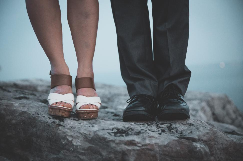 View Of A Man And Womans Feet Standing Next To Each Other