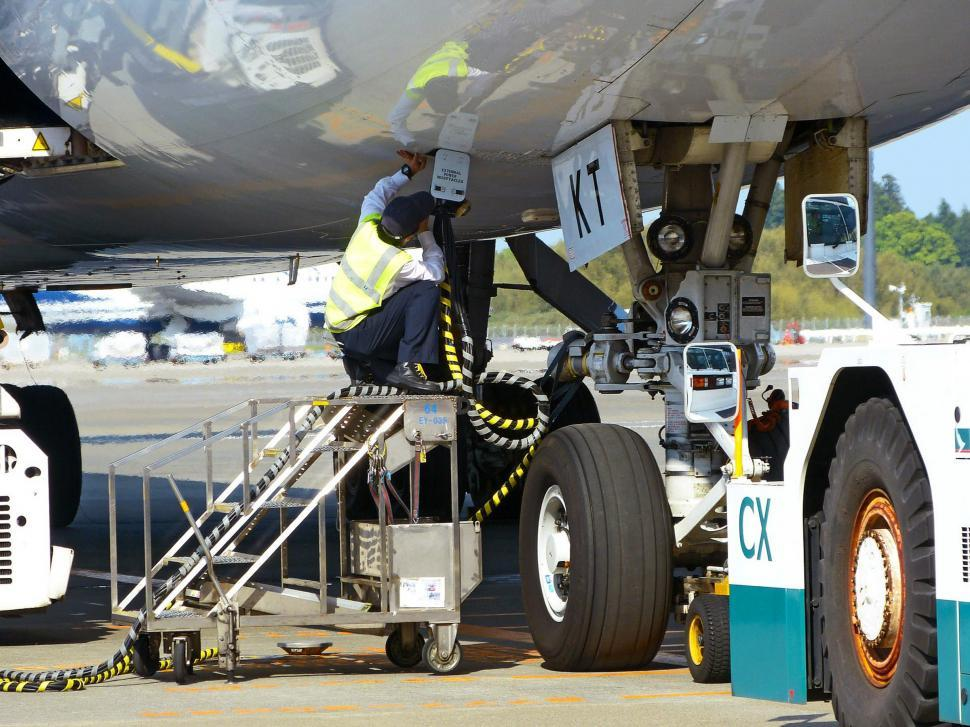 Download Free Stock HD Photo of Airport Maintenance Staff Online
