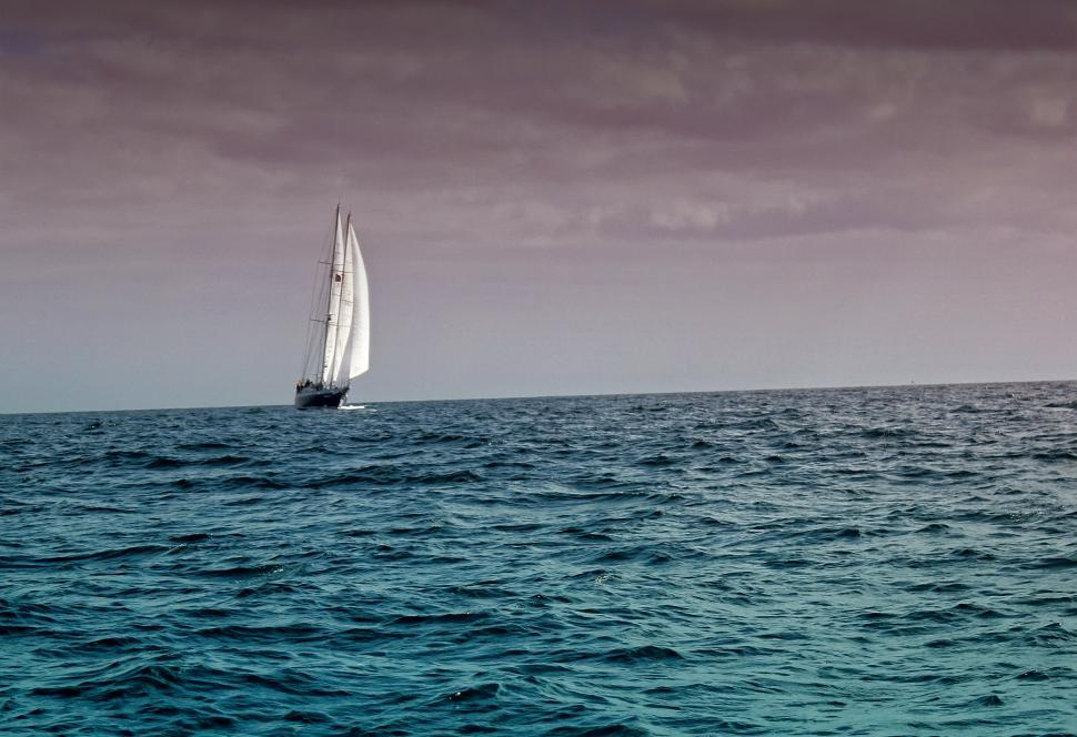 Download Free Stock HD Photo of Sail Boat Under Dark Skies Online