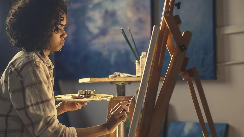Download Free Stock HD Photo of Artist Painting In Studio Online