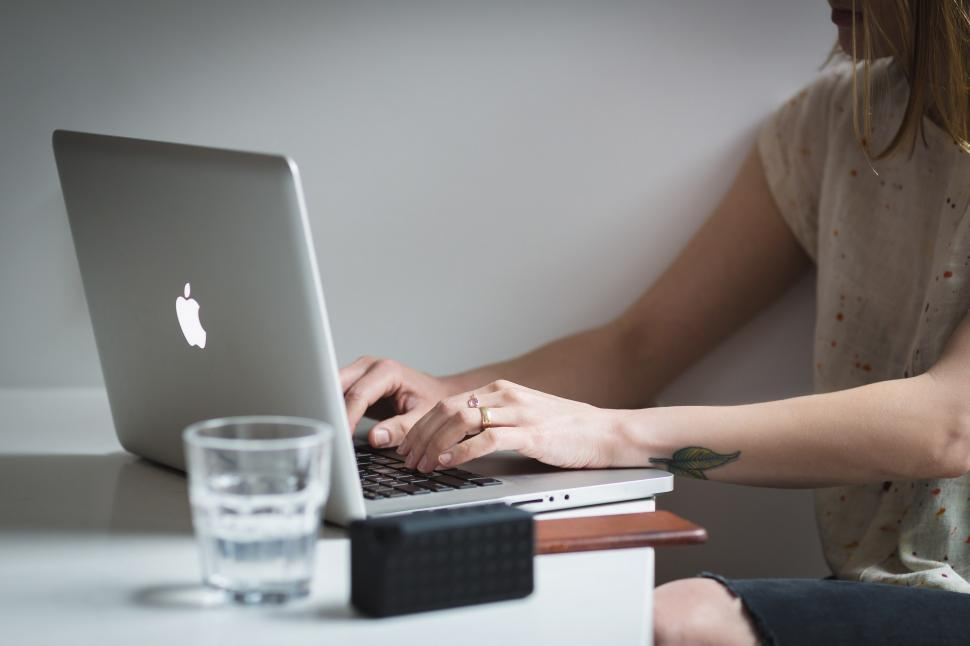 Download Free Stock HD Photo of Young Woman Typing Macbook Online