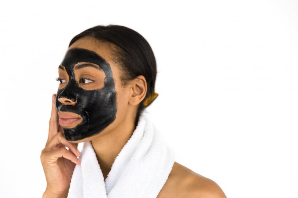 Download Free Stock HD Photo of Woman Applying Face Mask Online