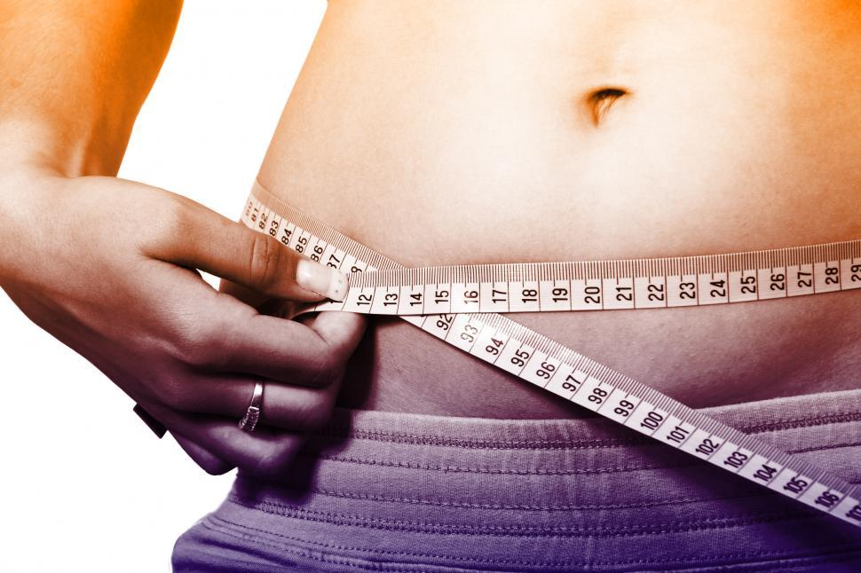 Download Free Stock HD Photo of Woman Measuring Waistline - How to Lose Weight Fast Online