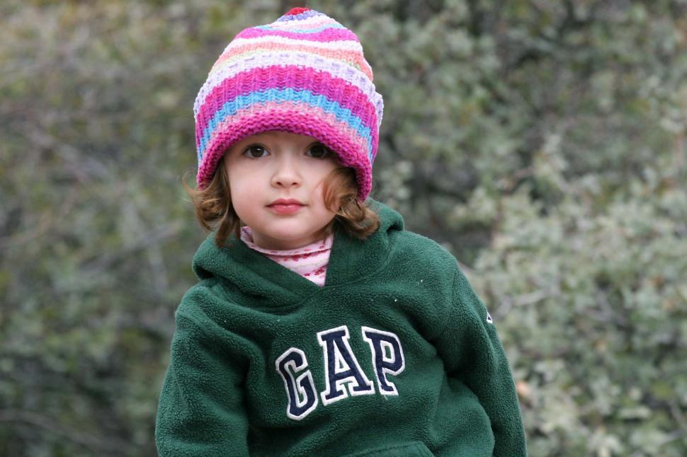 Free image of Cute young toddler in a sweatshirt and a knit cap