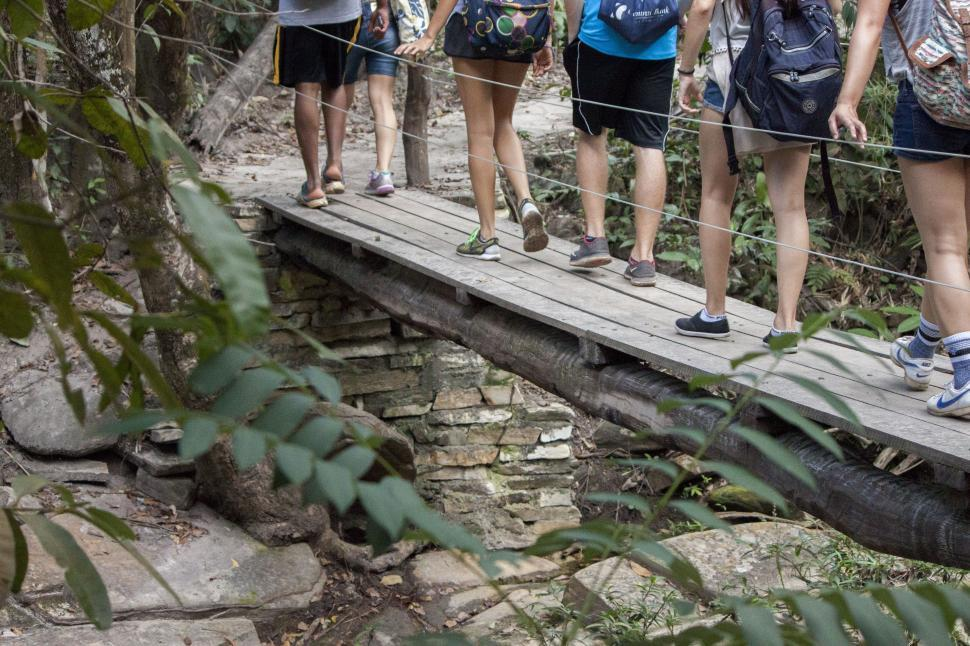 Download Free Stock HD Photo of Group crossing a wooden bridge Online