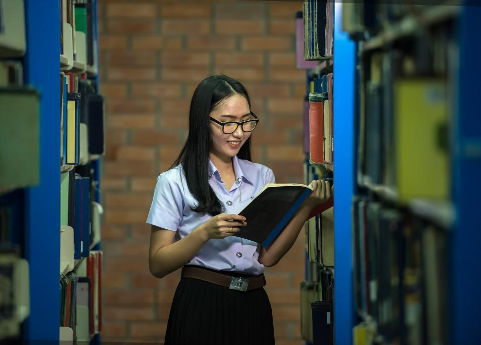 Download Free Stock HD Photo of Girl in the Library Reading Online