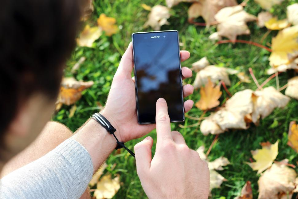 Download Free Stock HD Photo of Using Sony Smartphone Online