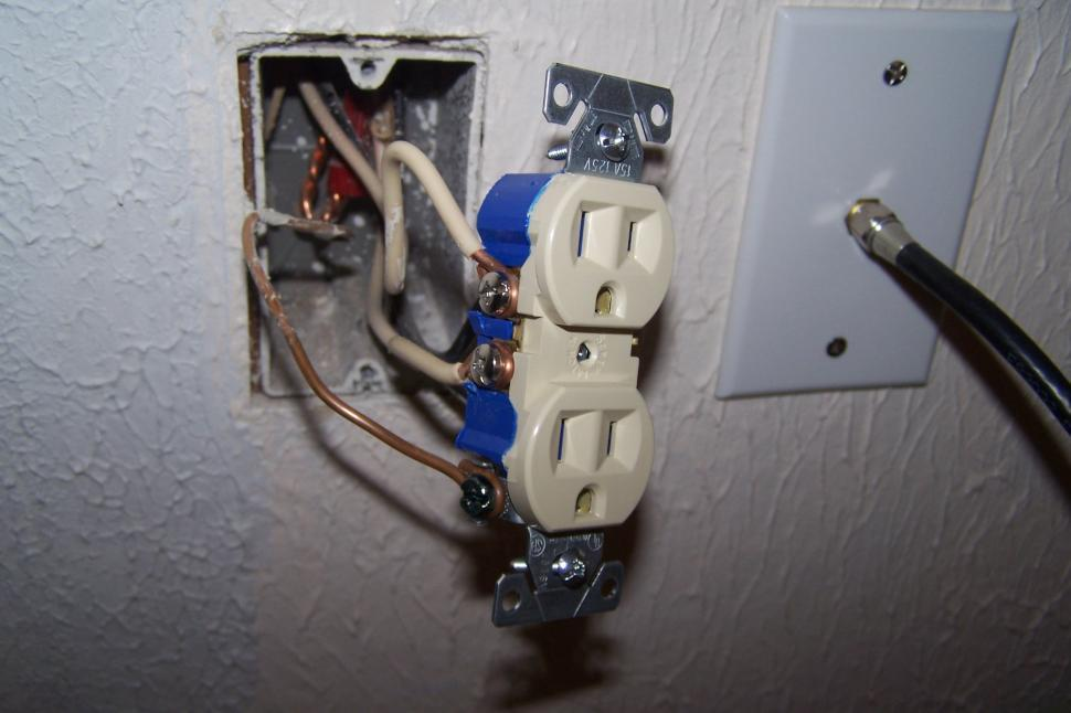 electric-outlet-exposed Exposed Wiring on