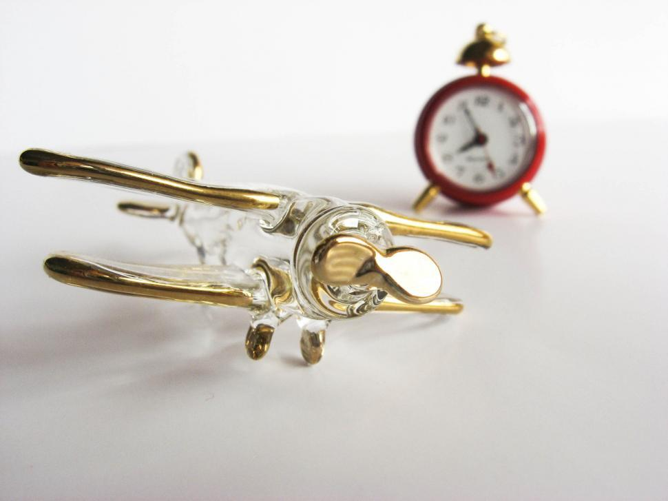 Download Free Stock HD Photo of airplane figurine and clock Online