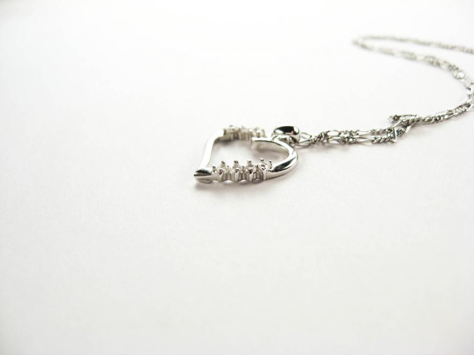 Download Free Stock HD Photo of silver necklace on white Online