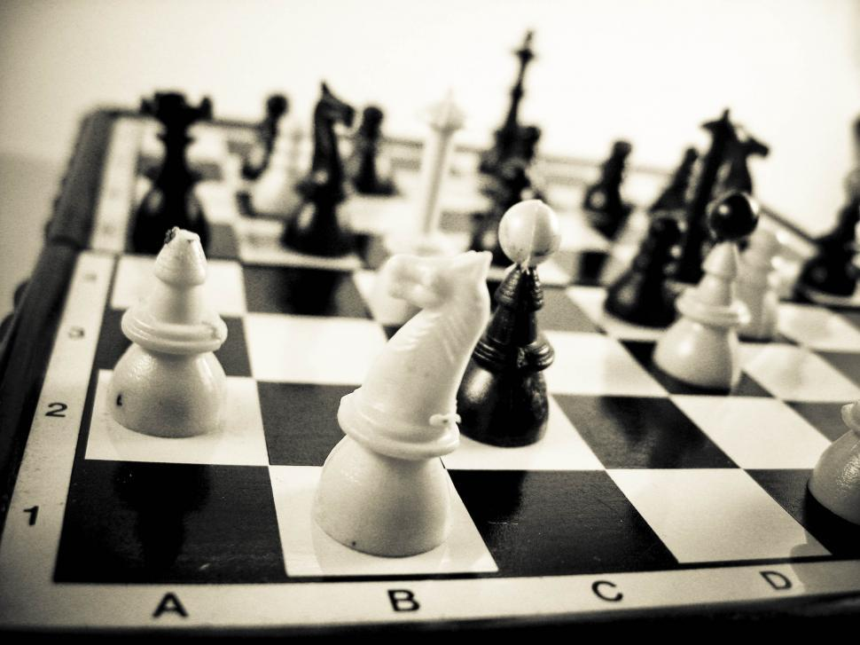 Download Free Stock HD Photo of chess figurines with board markings Online