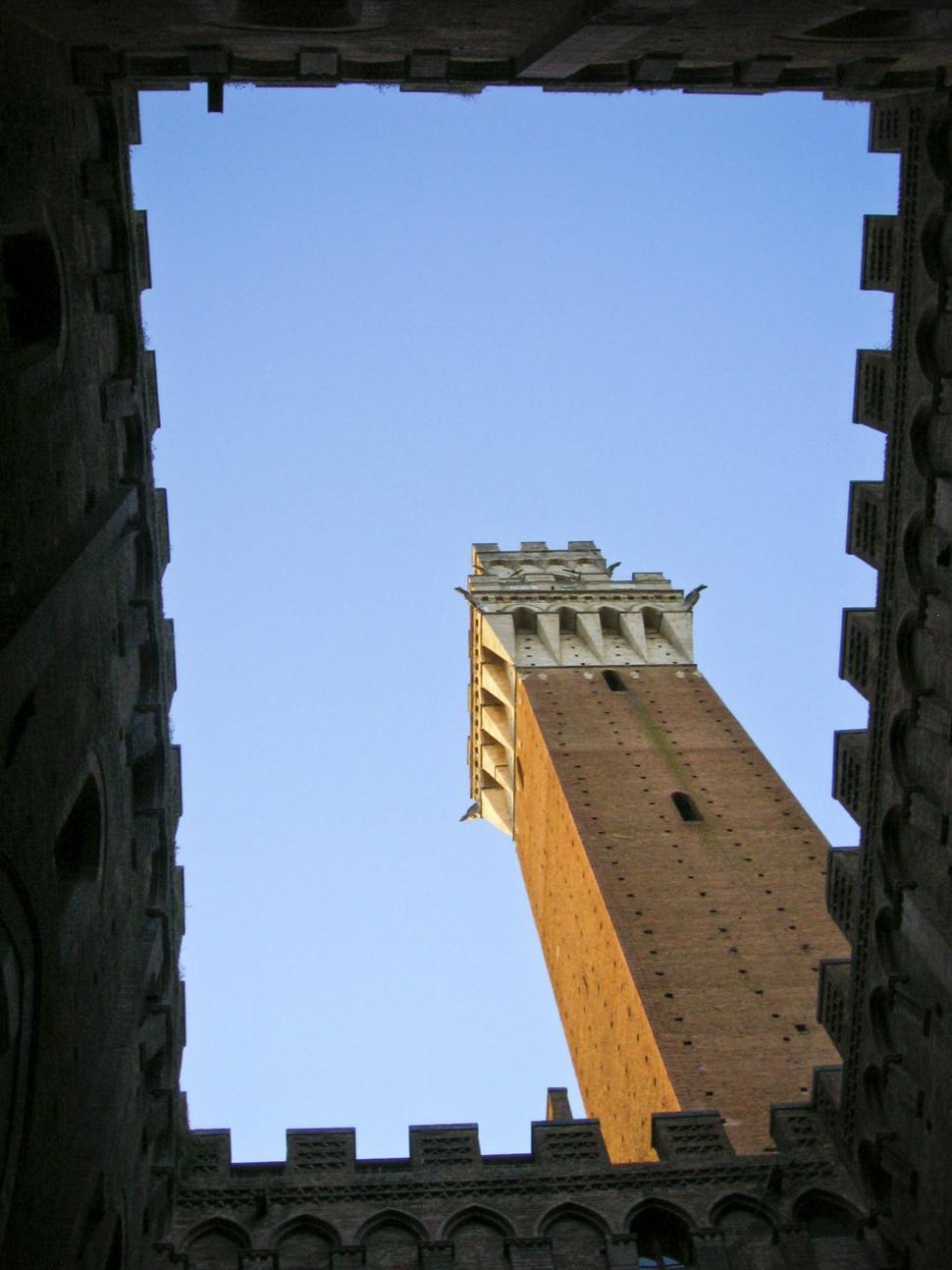 Download Free Stock HD Photo of Siena tower though opening Online