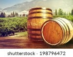 two wooden barrels on nature...
