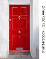 red entrance door in front of...