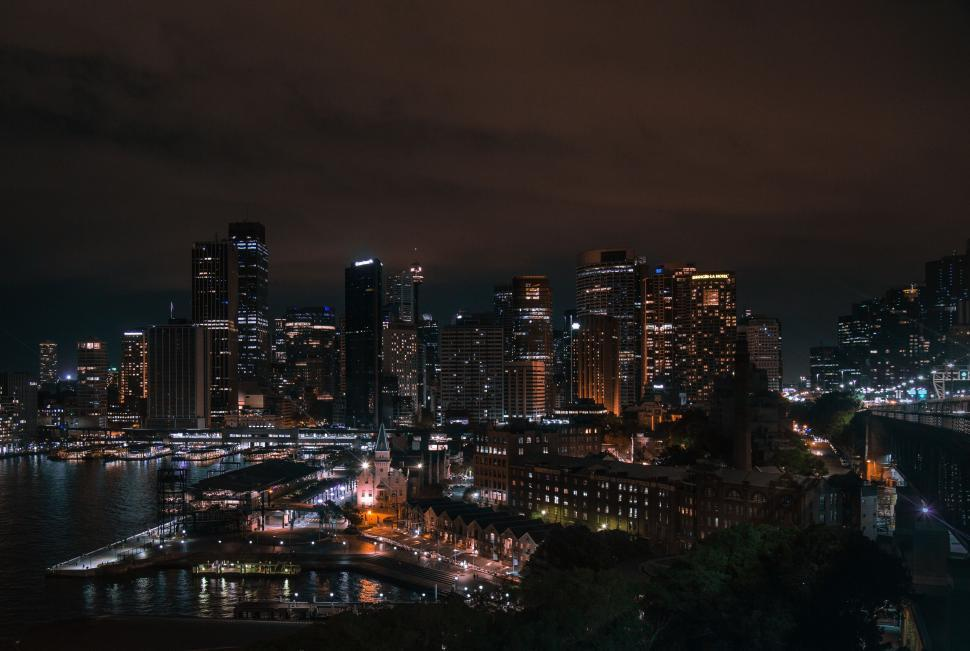 Download Free Stock Photo of city business district urban night cityscape skyline building architecture waterfront buildings tower skyscraper downtown manhattan river landmark sky travel skyscrapers