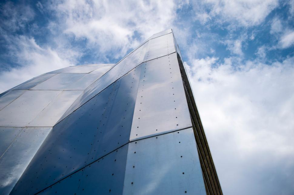Download Free Stock Photo of Buildings sky wing device airfoil travel water modern solar dish clouds architecture city