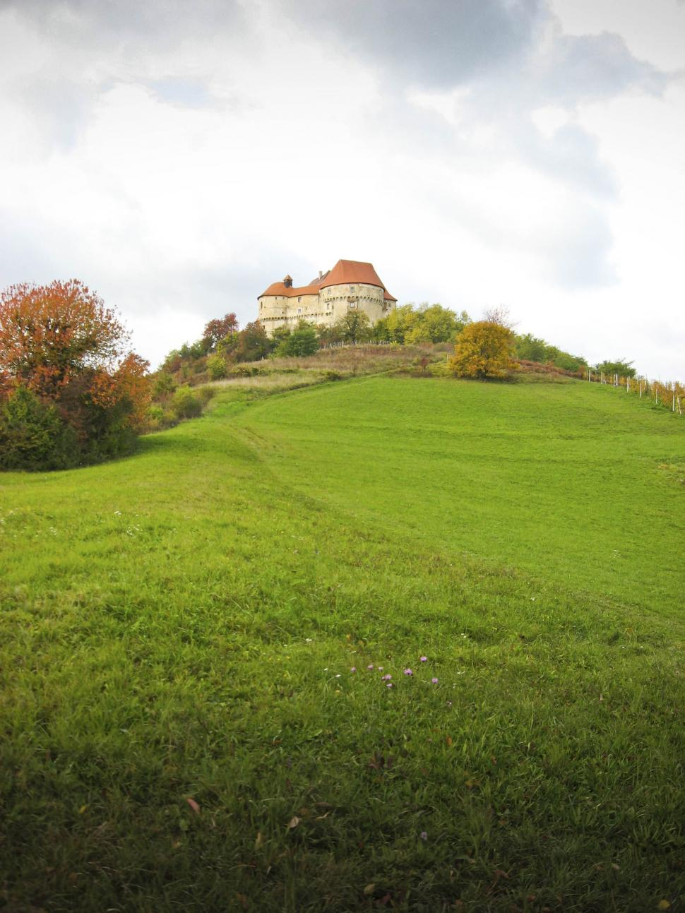 Download Free Stock HD Photo of castle on a hill of green Online