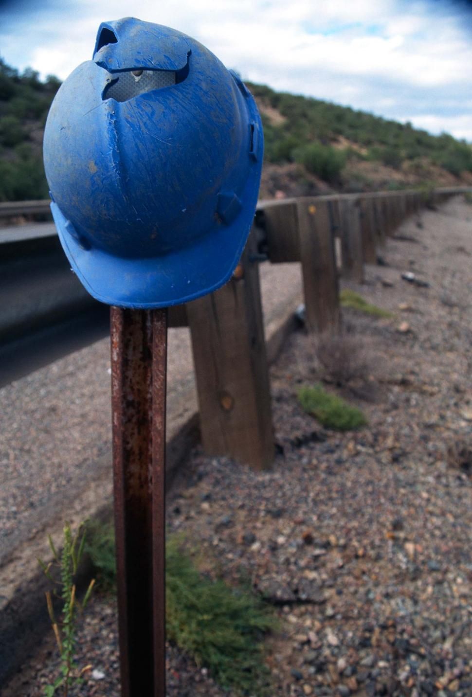 Download Free Stock HD Photo of Hardhat on a post Online