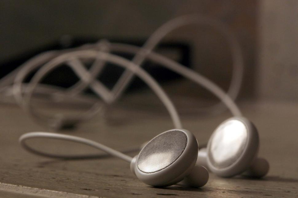 Download Free Stock Photo of Old white earbuds
