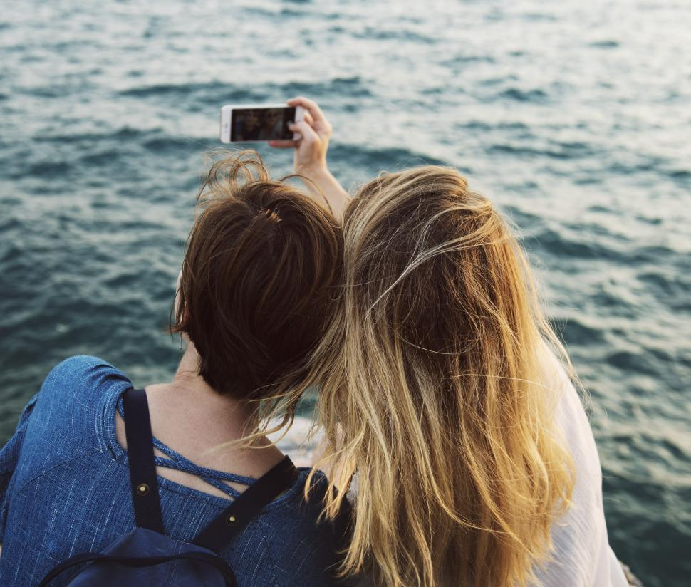 Download Free Stock HD Photo of Two Friends taking a Selfie Online