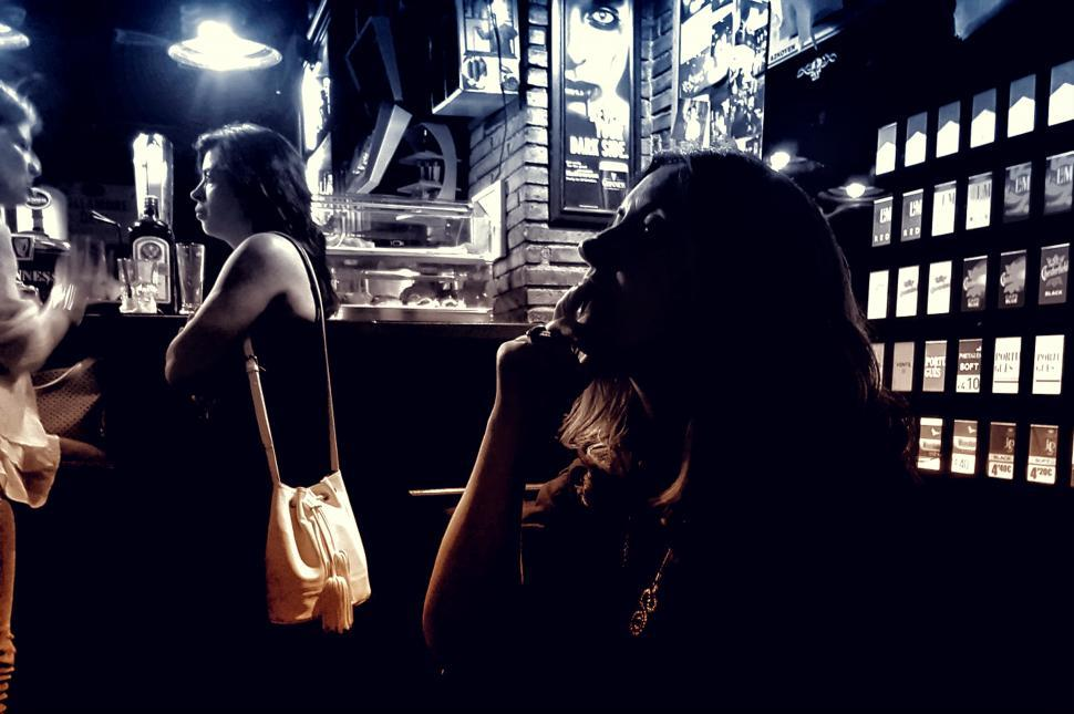 Download Free Stock Photo of People at a Bar - Dark Looks
