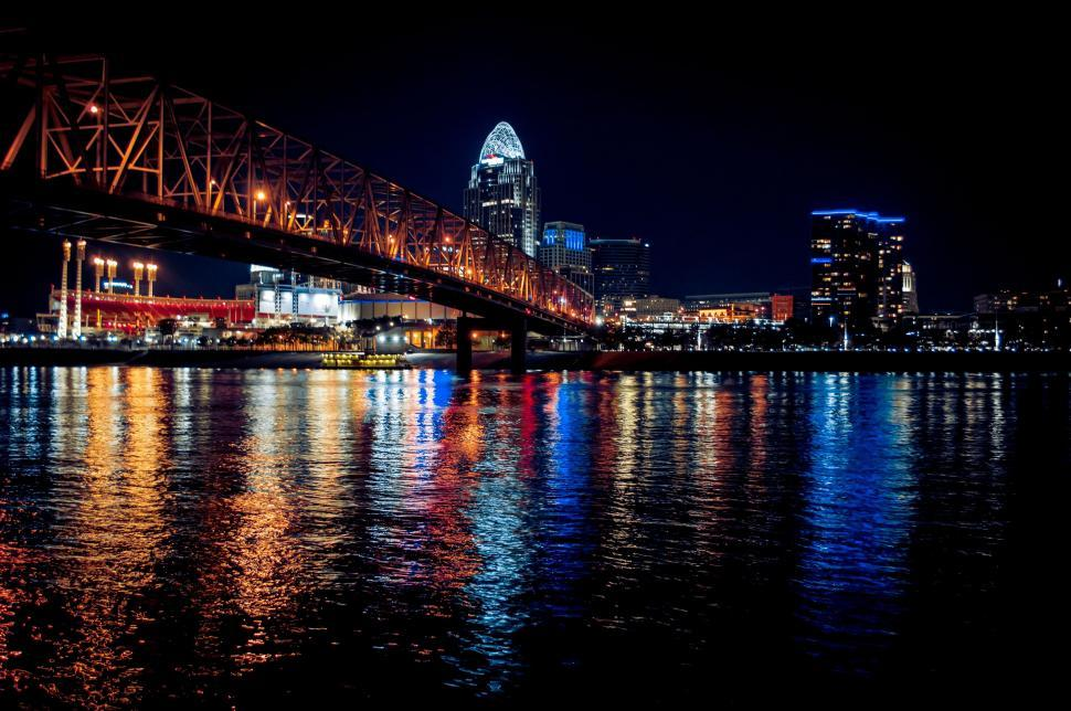 Download Free Stock Photo of waterfront city bridge pier skyline cityscape water building architecture urban night boat river sky buildings travel support tourism harbor downtown reflection landmark structure town device sea manhattan skyscraper ship