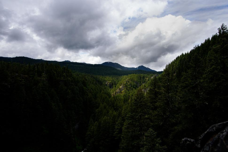 Download Free Stock Photo of mountain valley landscape range mountains geological formation sky forest travel peak scenic snow natural depression natural elevation rock tourism scenery outdoors trees alp clouds tree river alpine park environment cloud