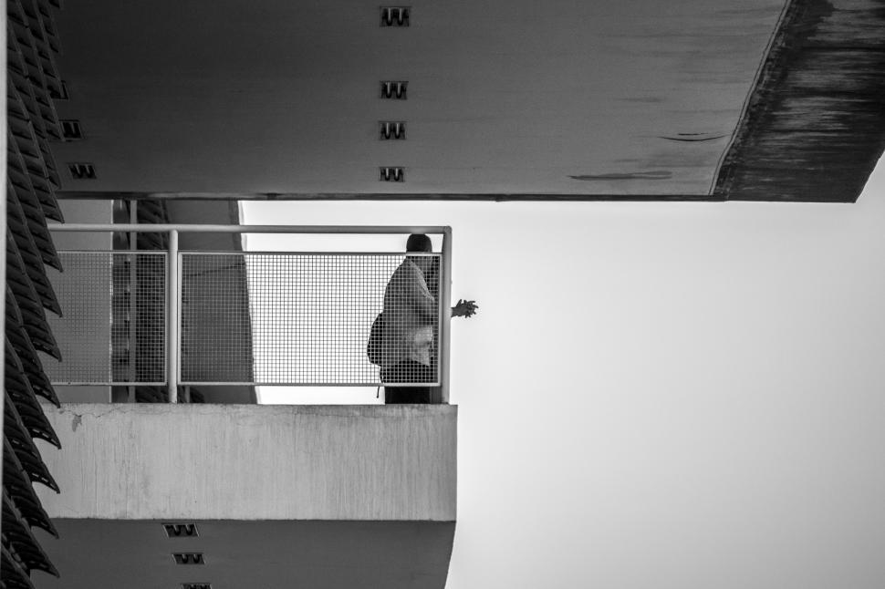 Download Free Stock HD Photo of Two People Talking Over Balcony Online