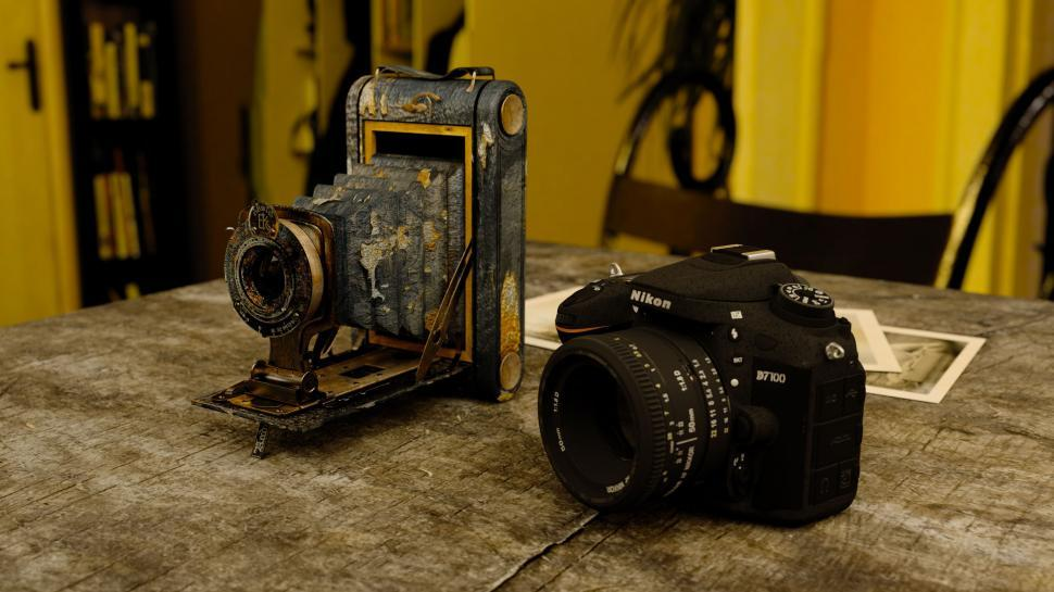 Download Free Stock Photo of Antique Camera and New Nikon Camera