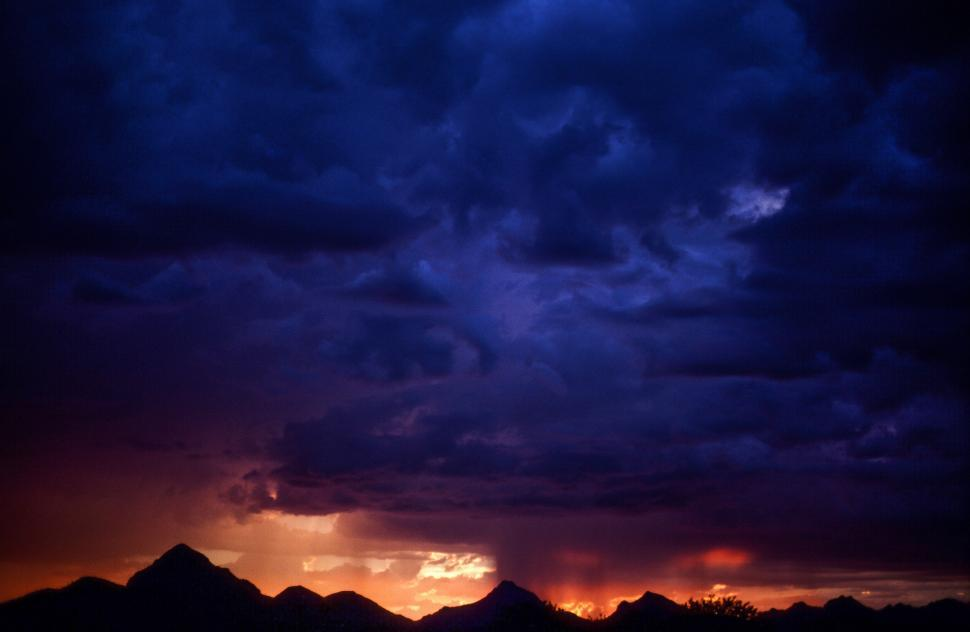 Download Free Stock Photo of Sunset Sky with storm clouds