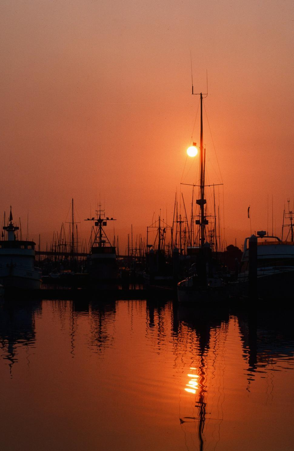 Download Free Stock Photo of Fishing boats in orange sunset