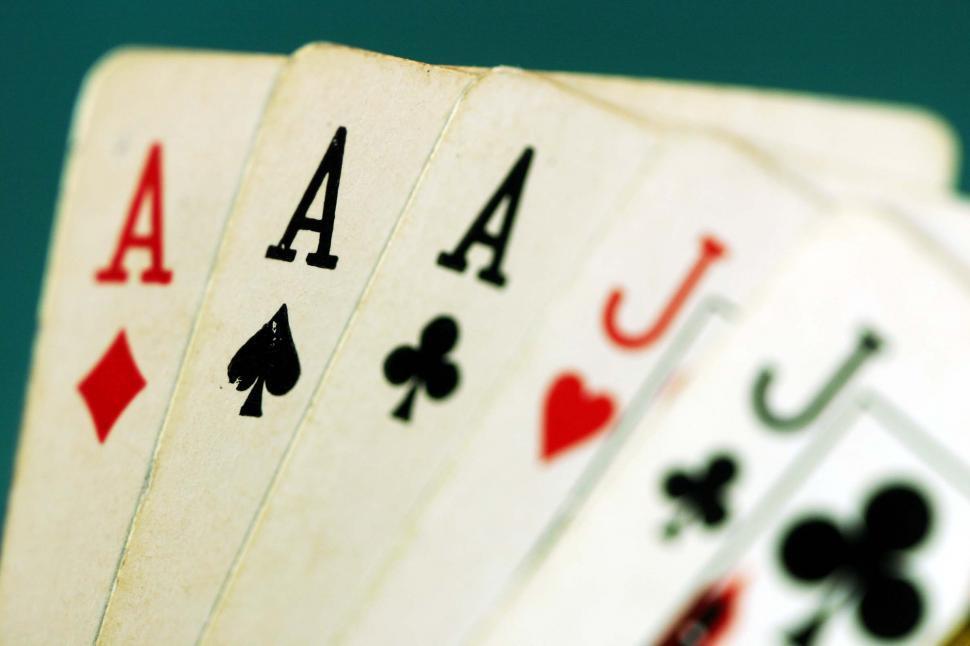 Download Free Stock Photo of playing cards games gambling gamble casino las vegas gaming ace ten winning hand poker full house aces jacks