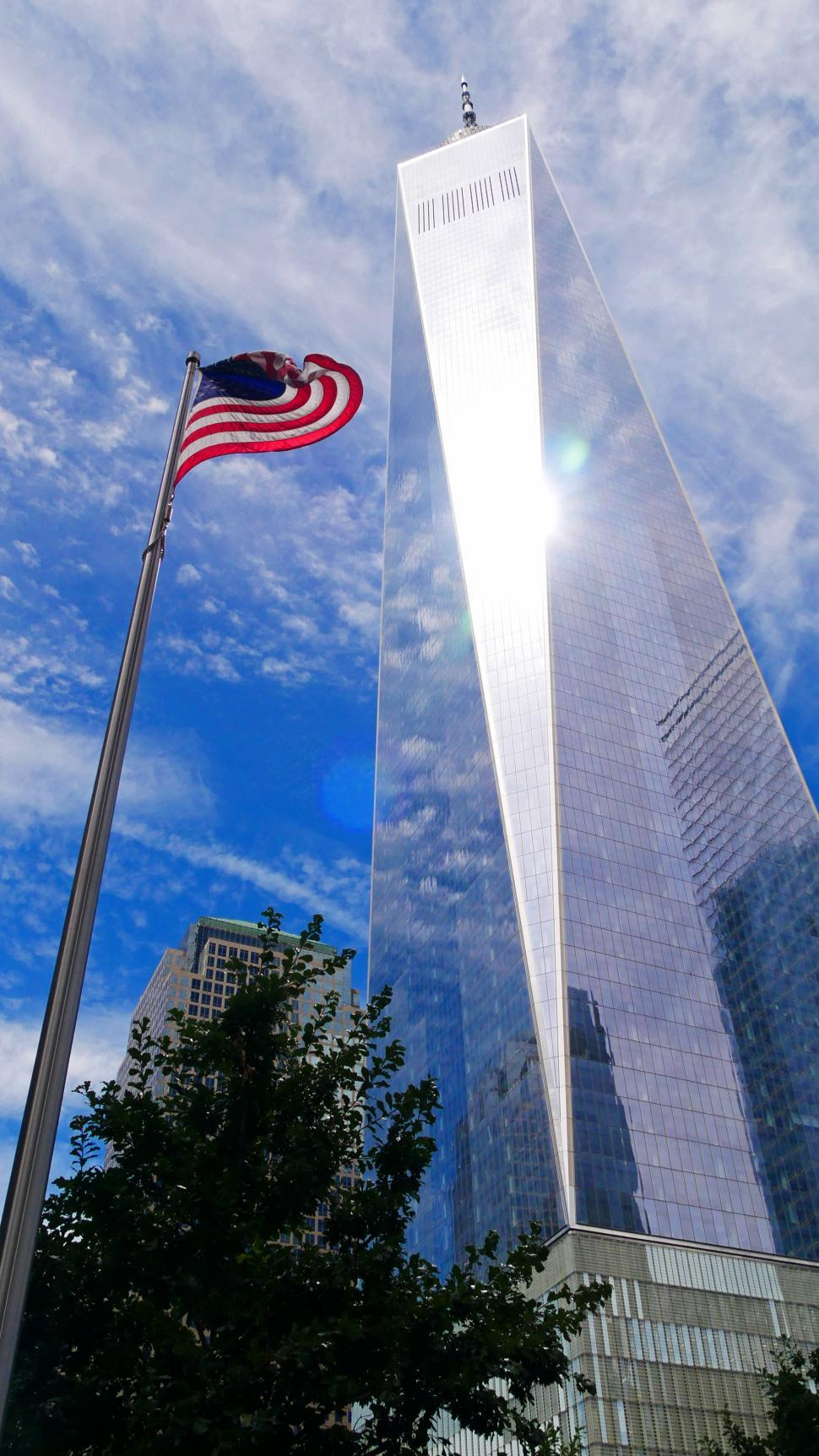 Download Free Stock Photo of One World Trade Center with US Flag