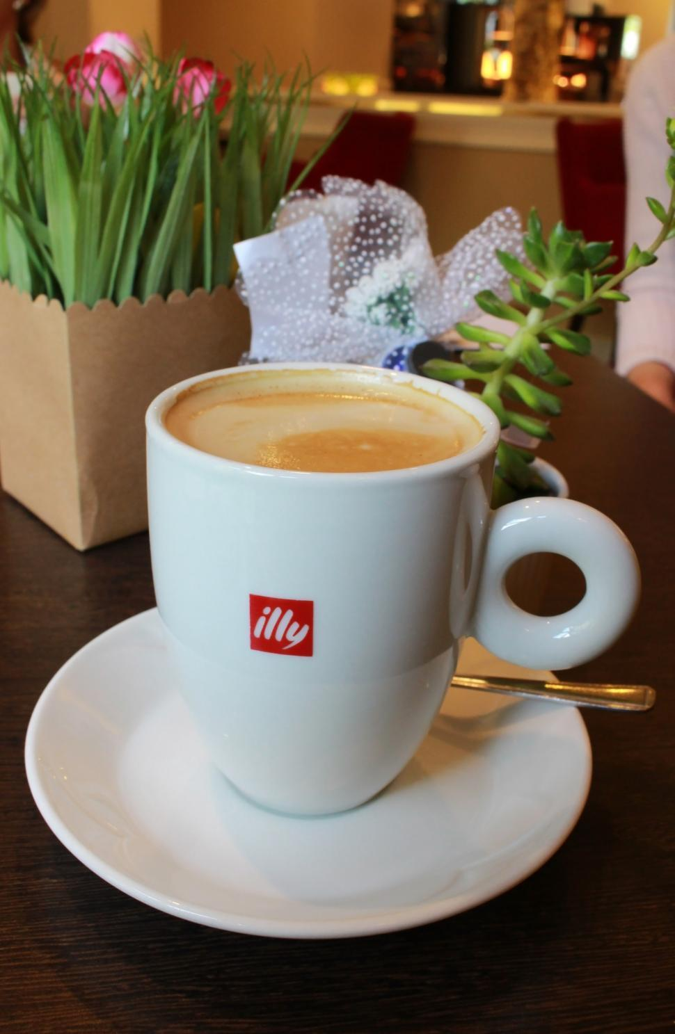 Download Free Stock HD Photo of Cup of Illy branded coffee  Online