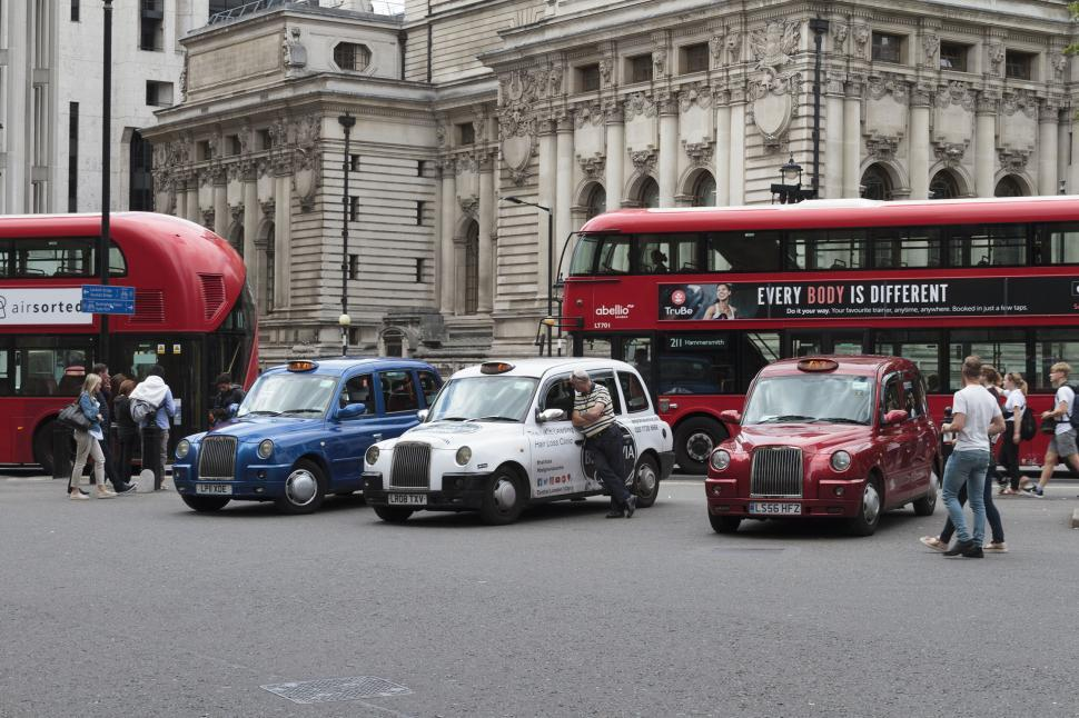 Download Free Stock HD Photo of Taxis and buses in London Online