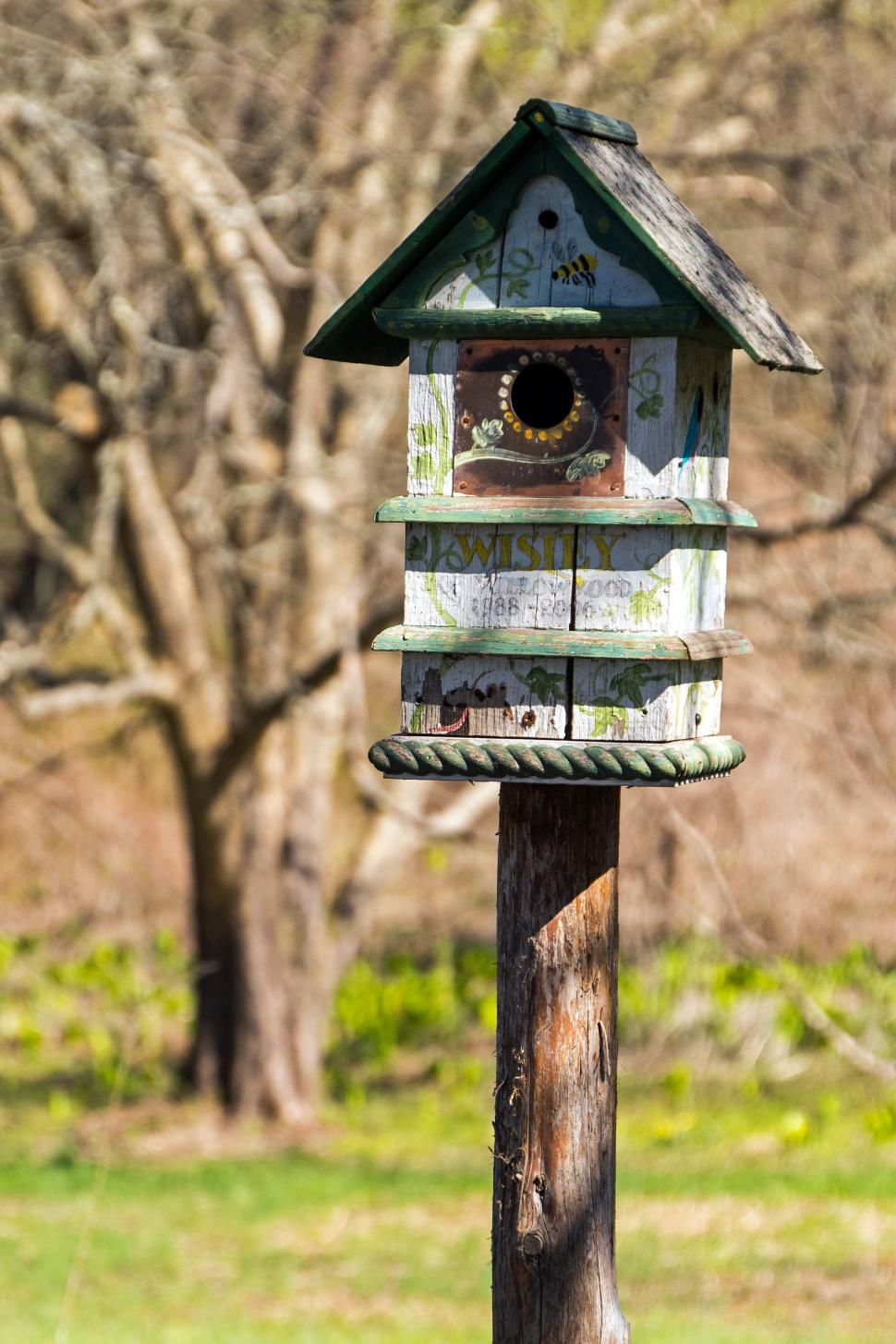 Download Free Stock HD Photo of Painted Birdhouse on a Post Online