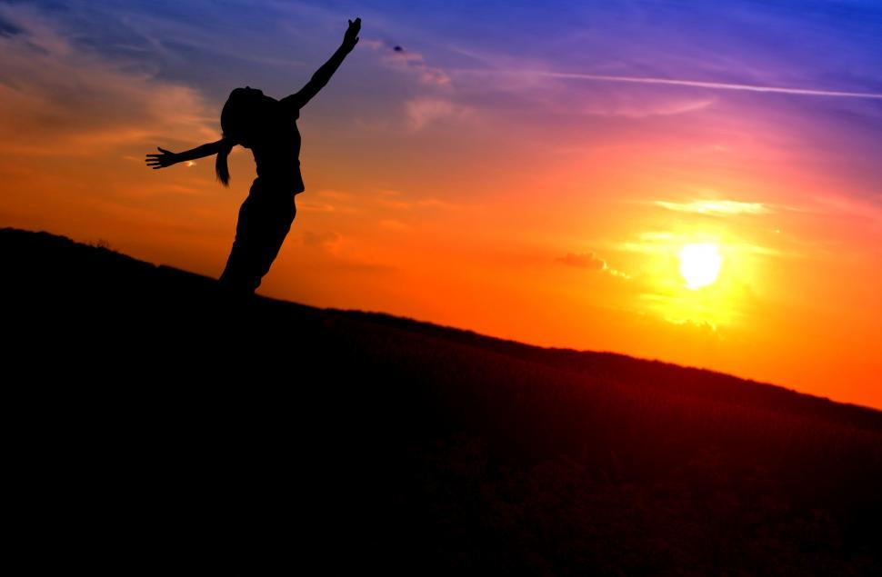 Download Free Stock Photo of Young Woman Stretching Her Arms Like Wings at Sunset - Enjoying