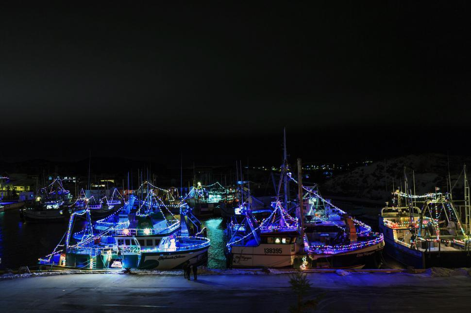 Download Free Stock HD Photo of Harbor with lighted fishing boats Online
