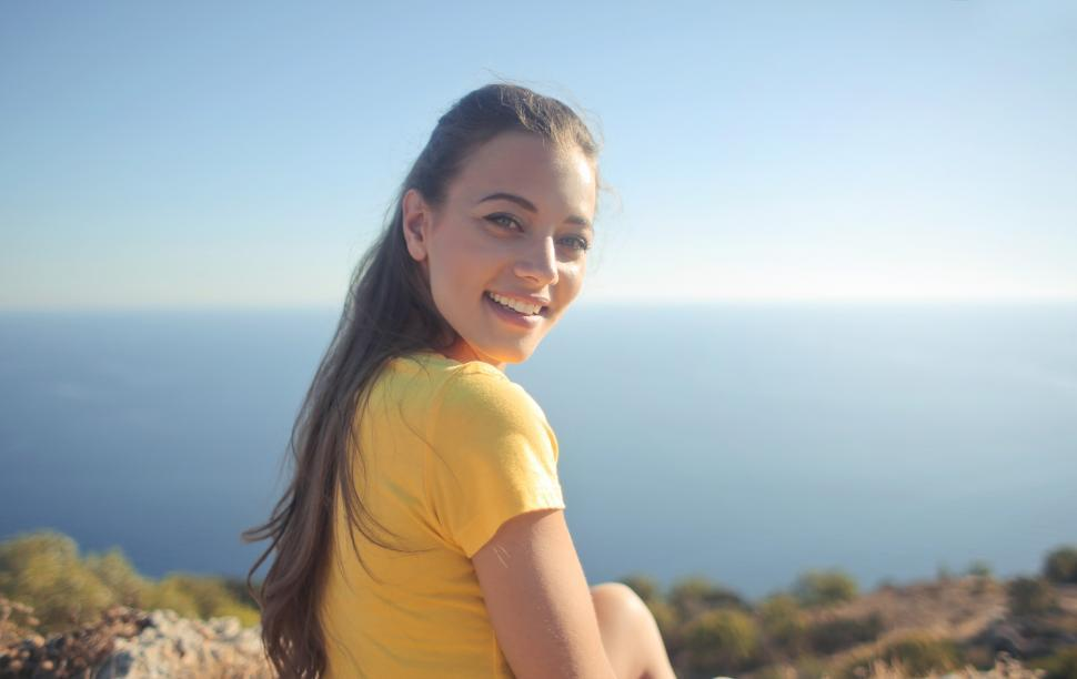 Download Free Stock Photo of Portrait of Young Woman In Yellow Shirt